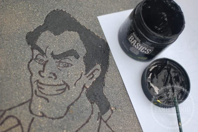 Gaston image on tombstone after filling in with black acrylic paint