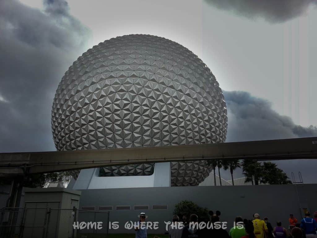 View of Spaceship Earth as runners enter Epcot
