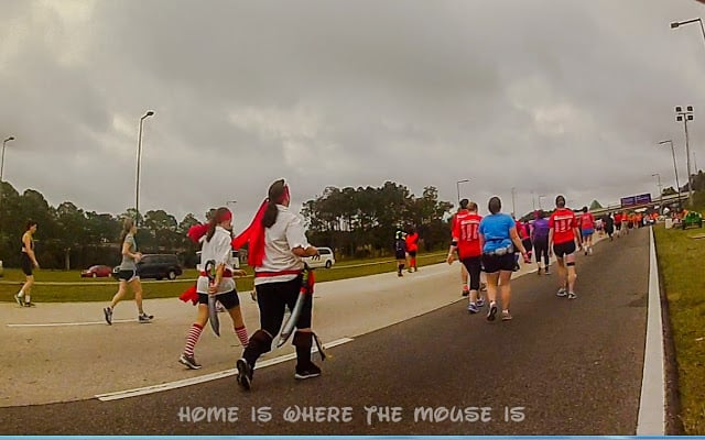 Runners on World Drive heading back to Epcot