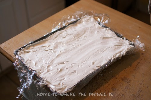 cover marshmallow with plastic wrap sprayed with cooking spray
