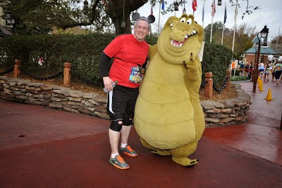runDisney | James poses with Louis in Magic Kingdom | WDW Half Marathon