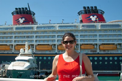 Lisa poses in front of the Disney Magic in Key West, Fl