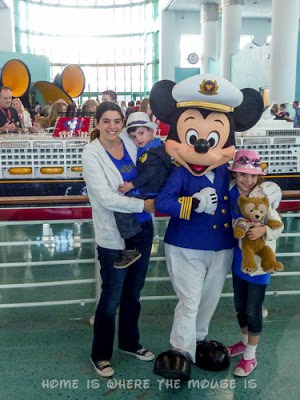Lisa, Bella and Jackson meet Captain Mickey inside the Disney cruise terminal in Port Canaveral