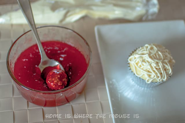 Dip the candy into the preserves and set atop the cupcake