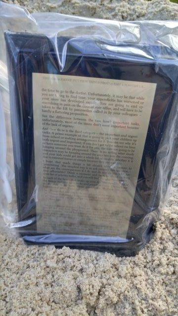 Kindle inside a Ziploc Bag