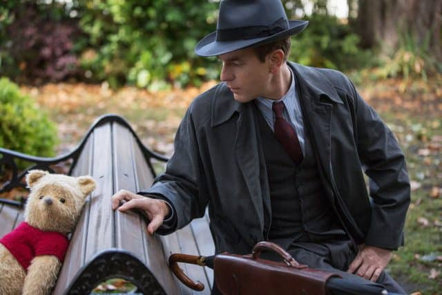Pooh and Christopher Robin on bench