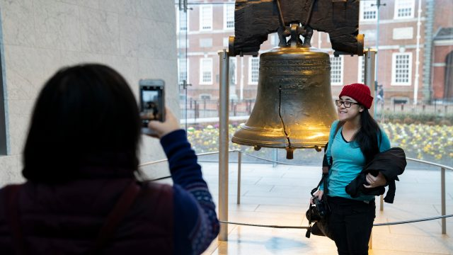 Family taking photo with Liberty Bell in Philadelphia