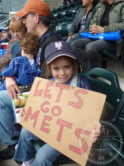 Bella holding her Let's Go Mets sign at the ballpark