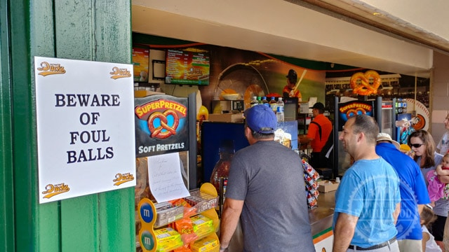Beware of Foul Balls sign at ballpark concession stand
