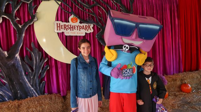Bella and Jackson meeting Jolly Rancher character at Hersheypark in the Dark