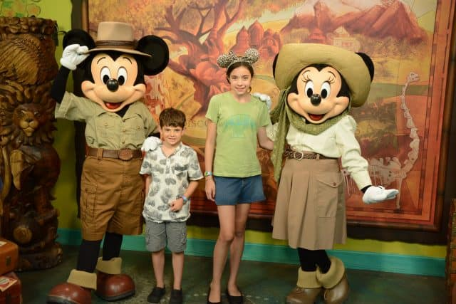 Jackson and Bella pose with Mickey Mouse and Minnie Mouse at the Adventurer's Outpost