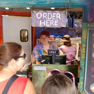 Lisa ordering one of the best animal kingdom snacks at Pongu Pongu