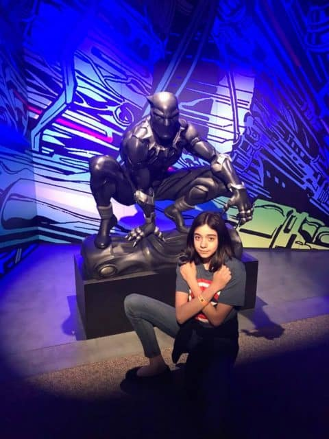 Bella poses with Black Panther at the Marvel Universe of Super Heroes Exhibit