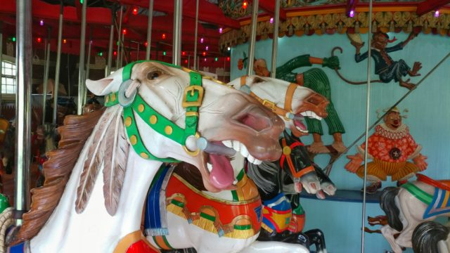 the central park carousel was built in coney island. The horses exhibit the coney island style with their exaggerated features.