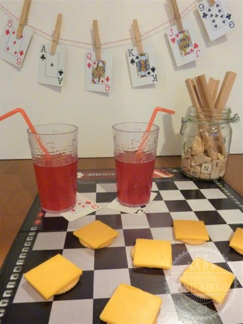 Family game night cheese and crackers on a checker board