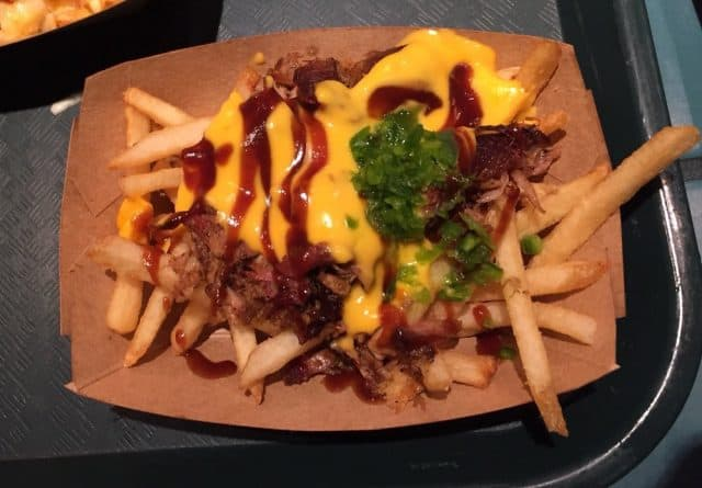 french fries topped with pulled pork, melted cheese, and barbecue sauce