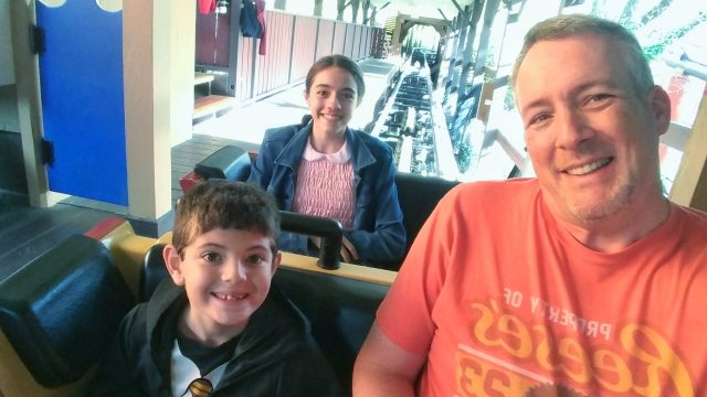 James and the kids on a roller coaster at Hersheypark