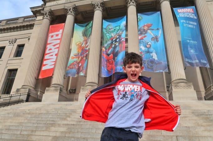 Jackson poses in front of the Franklin Institute for the Marvel Universe of Superheros Exhibit