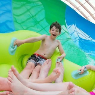 Jackson riding Nor Easter water slide at Kartrite water park