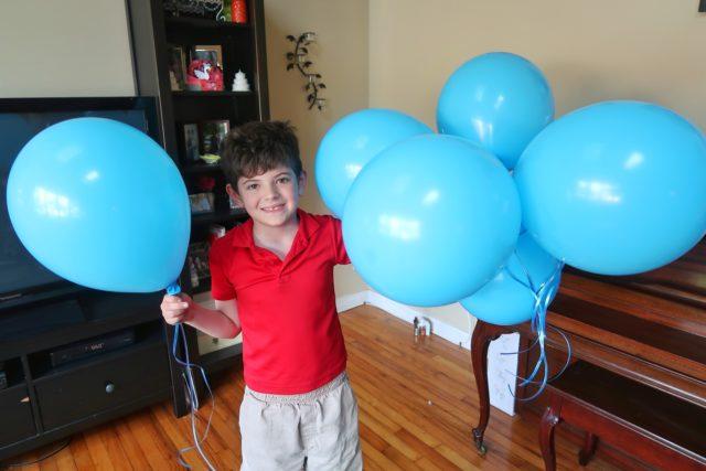 Jackson holding blue Bunch O Balloons