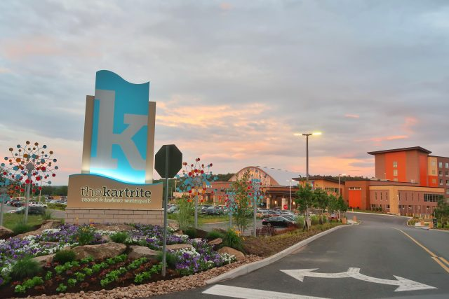 A colorful sky at sunset is the backdrop for this view of the Kartrite Resort's entrance.