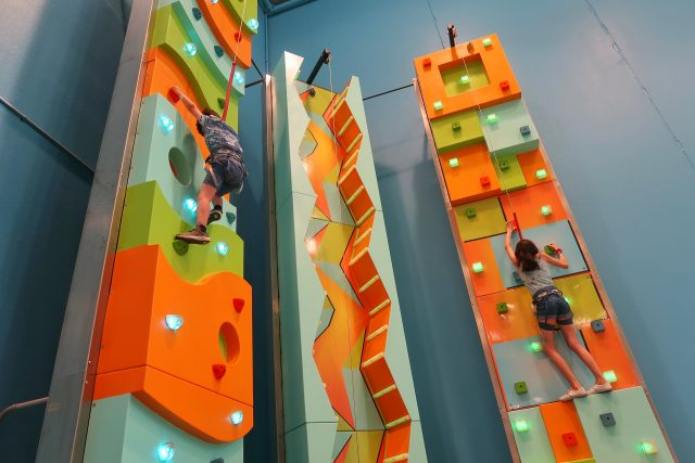 Jackson and Bella climb 2 of the three climbing walls at the Kartrite resort.