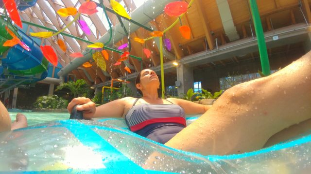 Lisa relaxes on her tube in the lazy river at the Kartrite Resort's indoor water park