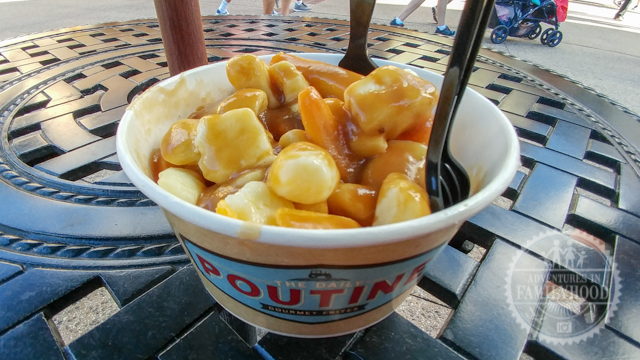 Classic poutine in a cup on a table