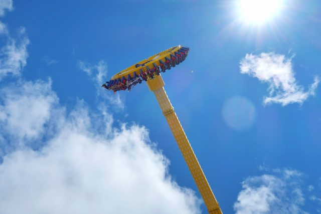 View of the Lasso of Truth from below as the ride hits its highest point in the sky