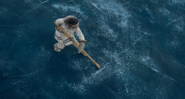 """francois testing the strength of the ice in the movie """"The Call of the Wild"""""""