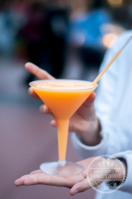 lisa holds the grand marnier slush in France pavilion at Epcot
