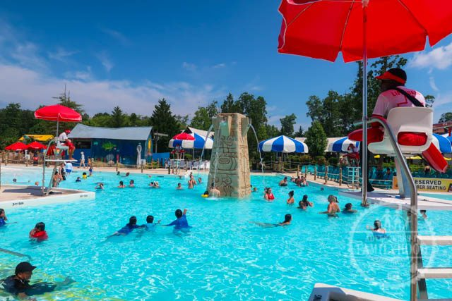 lifeguards scan pool from their chairs around the new calypso springs pool