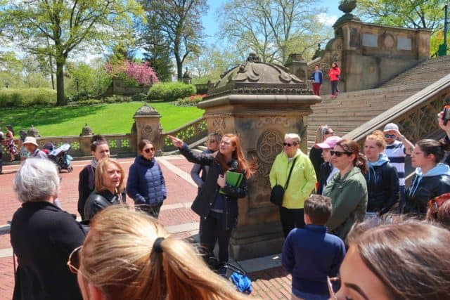on location tour guide giving walking tour of central park