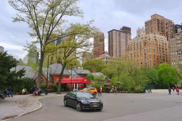 tavern on the green restaurant in central park. in the background, the building used in ghostbusters looms overhead